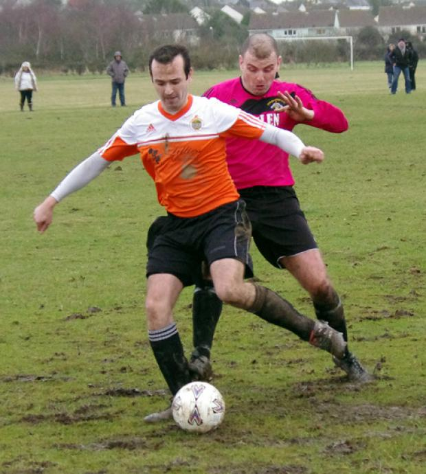 Western Telegraph: Sports centre back Kevin Berry is put under pressure by Bridge's Stuart Gray.