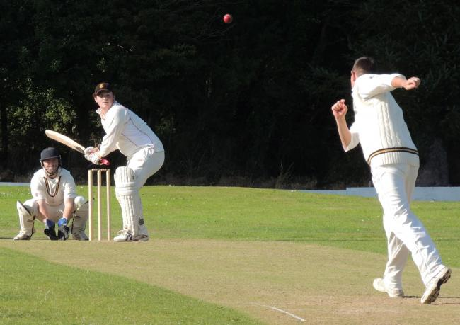 Llangwm skipper Jonathan Twigg bowls his team's last ball in Division One, which Rhys Davies hit for six to help Carew win (1004346)