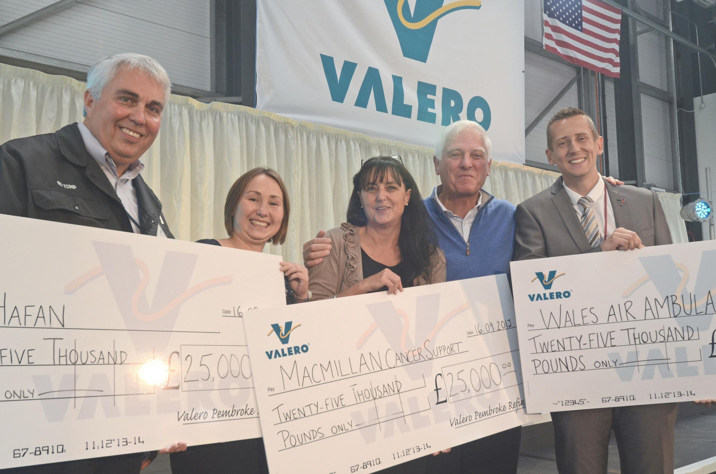 SURPRISE DONATION: Valero Pembroke Refinery general manager Ed Tomp, Ty Hafan's Priscilla Bowden, Macmillan Cancer Support's Sue Reece, Valero chairman and CEO Bill Klesse and Wales Air Ambulance's Mark Stevens.  PICTURE: M