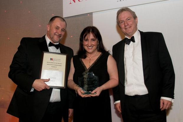Western Telegraph: Innovation in Nursing runner-up: Paula Jeffery of the Welsh Ambulance Services, pictured with Peter Meredith-Smith of the RCN in Wales and Nigel Harris, chairman of category sponsors, Frontier Medical Group. (2974025)