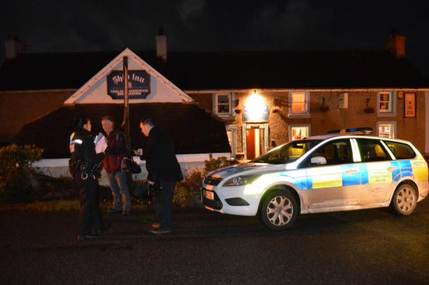 Police at the Ship Inn, Trefin, following reports of a 'plane crash'.The search was later called off.