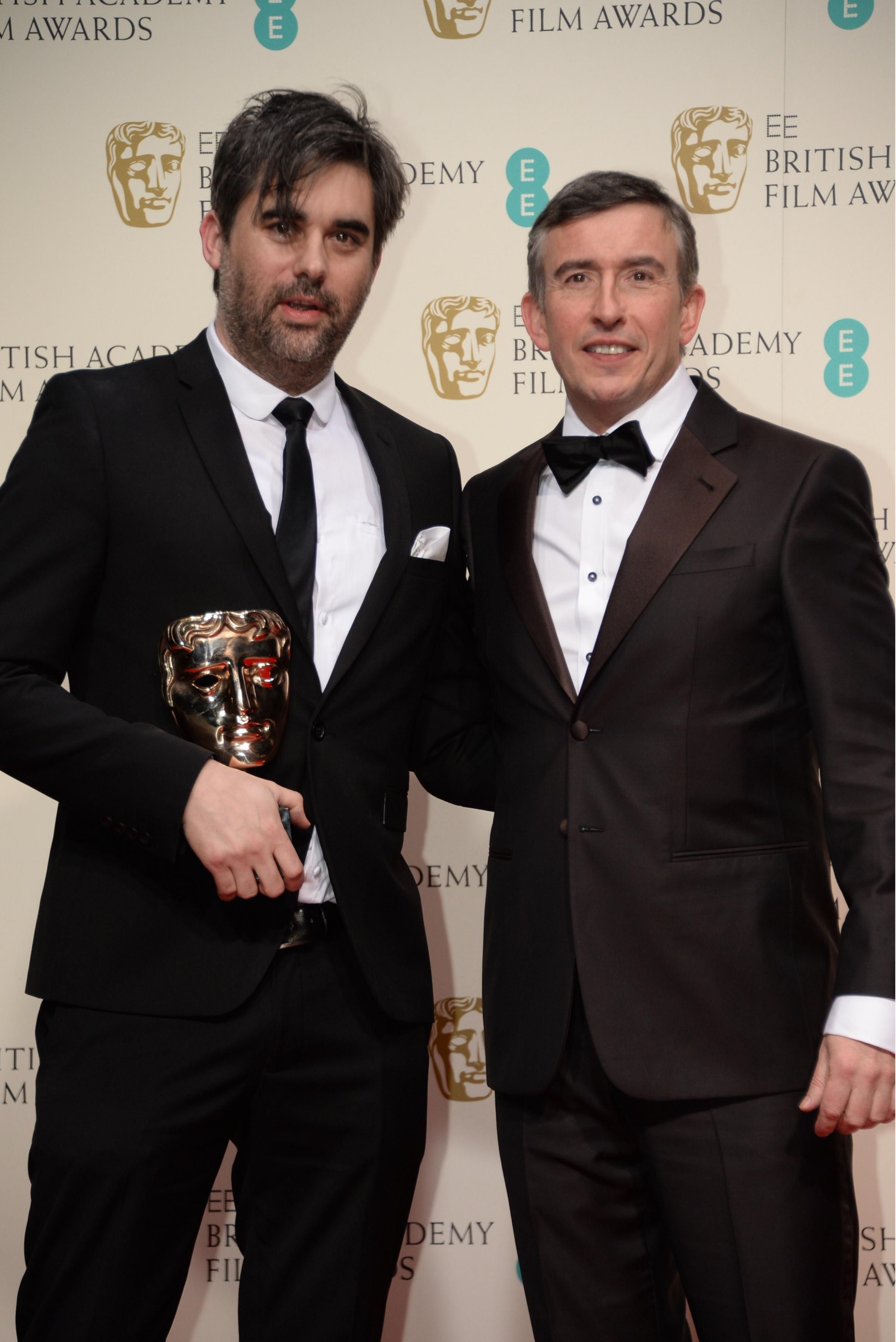OUTSTANDING DEBUT: St Davids film maker Kieran Evans received his BAFTA from actor Steve Coogan PICTURE: Richard Young/REX (4039203)