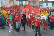 School children proudly display their fiery creation at last year's parade. PICTURE: Western Telegraph