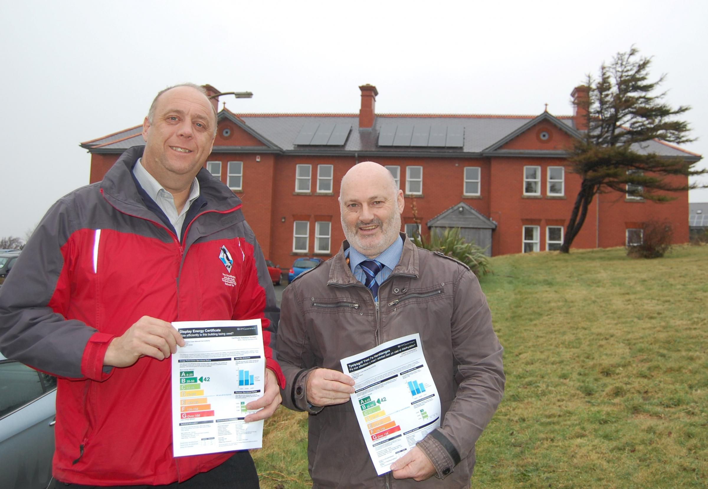 ENERGY EFFICIENT: National Park Authority Building Projects Officer Andrew Muskett and Chairman Cllr Mike James with the Display Energy Certificate outside the Pembroke Dock headquarters. (4311390)