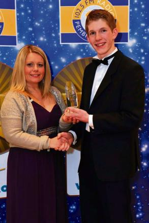 TASTY WIN: Anna Malloy, of award sponsor Port of Milford Haven, with Rhodri Maiden, winner of the Young Entrepreneur award.