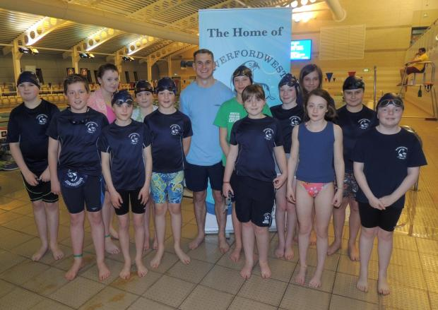 Western Telegraph: ALL SMILES BEFOREHAND: Fraser with Seals swimmers before the session.