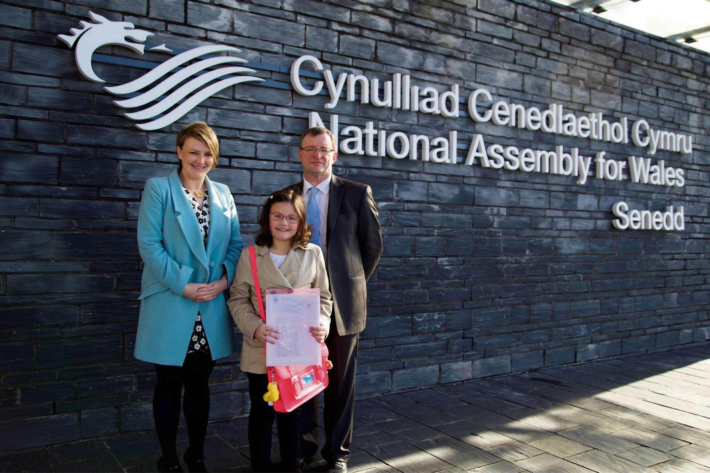 Megan, 9, presents petition to save hospital services