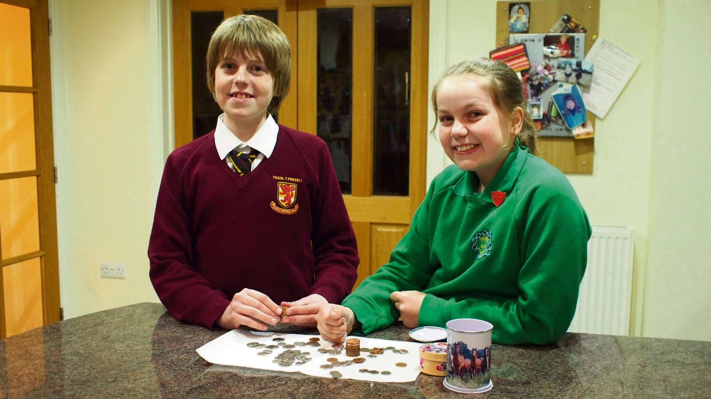 Haverfordwest siblings replace charity box cash after shop burglary