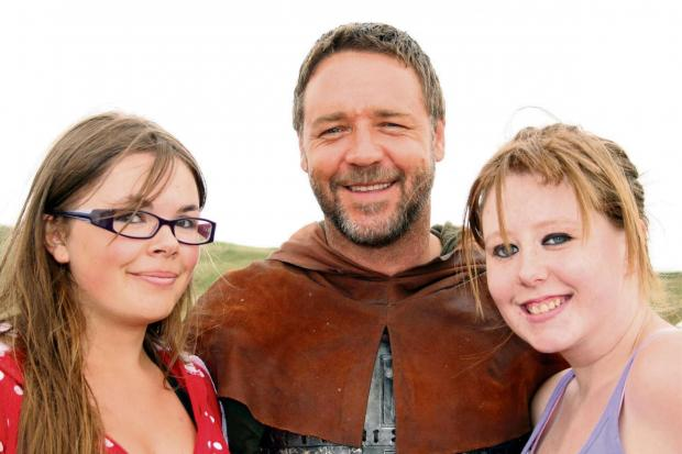 STAR POWER: Russell Crowe was happy to pose with fans on the set of Robin Hood at Freshwater West