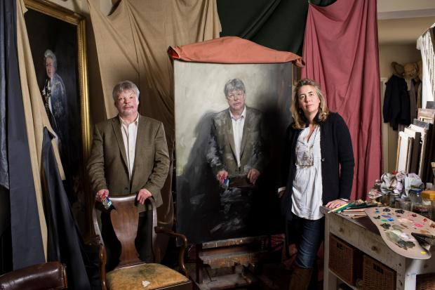 GREAT BRITONS: Nicky Phillips with the unfinished portrait of Simon Weston in her studio in London. PICTURE: Julian Calder. (5097946)
