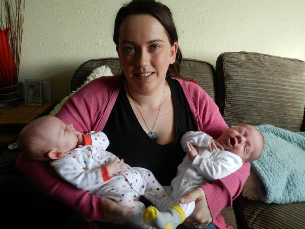 THANK GOODNESS FOR WITHYBUSH: Jamie-Lee Irving with twins Harry (left) and Thomas, now doing well at home.PICTURE: Western Telegraph. (5230034)