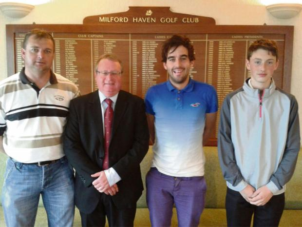 Western Telegraph: MONTHLY MEDAL: Karl Rhead, Sean Conway and Josh Lewis with club captain Gwyn Scales. (5237716)
