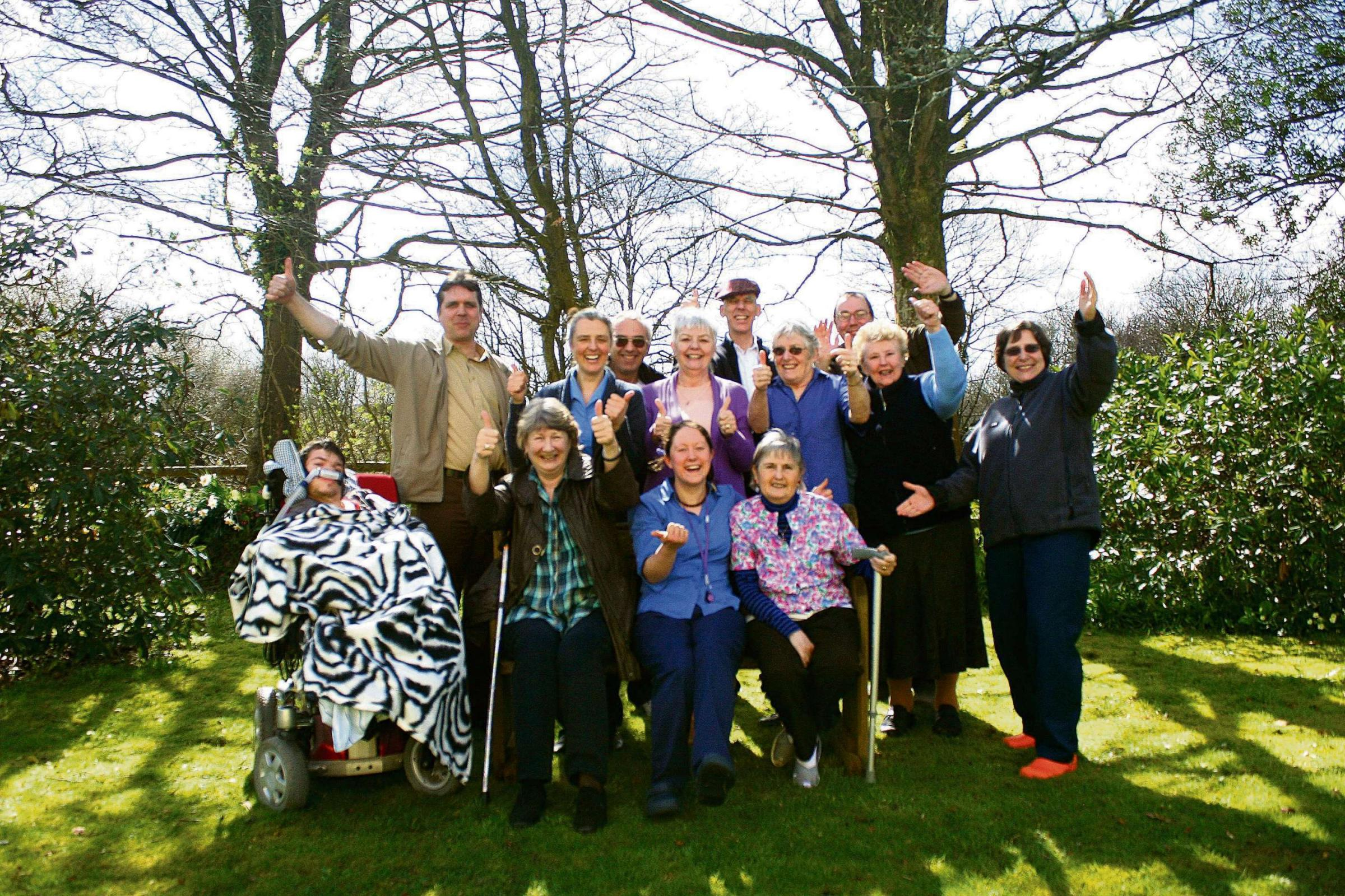 Thanks a (half) million! Skanda Vale hospice volunteers and patients celebrate the Lottery grant.  (5400595)