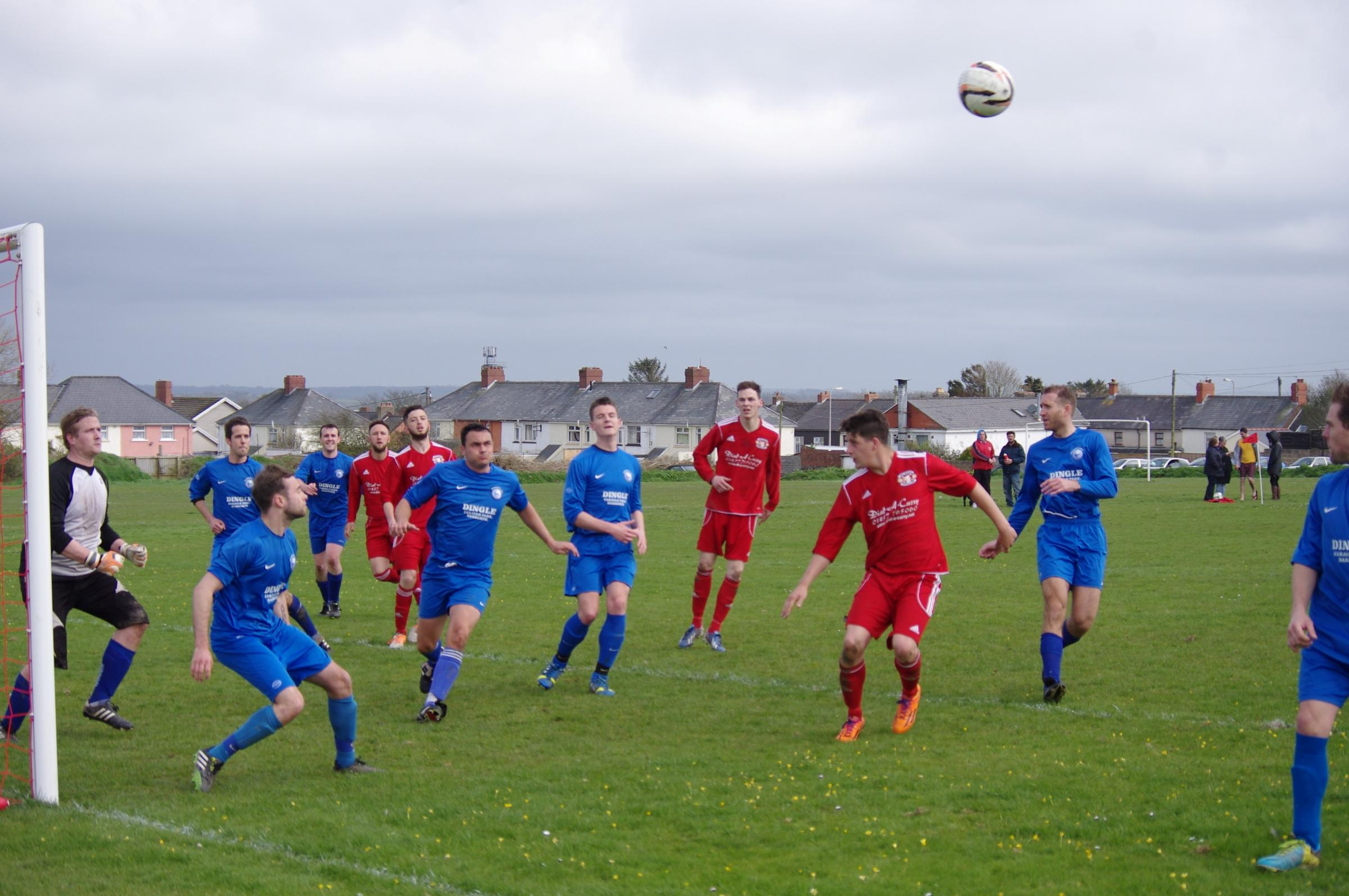 EYES ON THE BALL: Narberth defend a corner against West Dragons. PICTURE: Western Telegraph. (5418