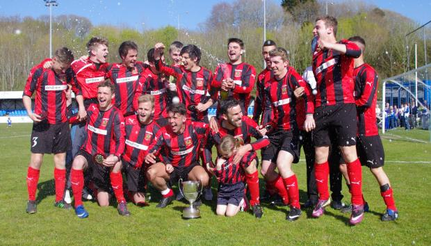 Western Telegraph: CELEBRATION TIME: The Tenby squad celebrate on the Meadow after winning the Senior Cup.