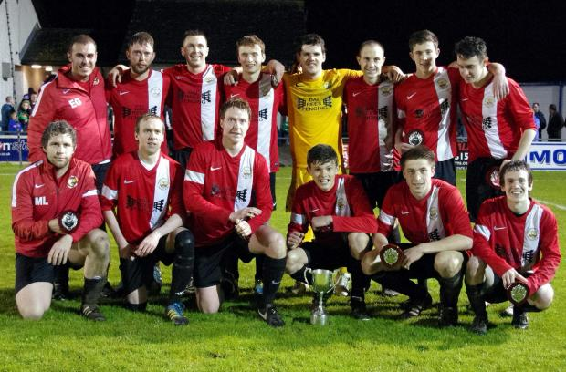 JUST CHAMPION: Victorious Clarbeston Road pose with the Second Division Cup after beating Solva in extra time.  PICTURE: Western Telegraph