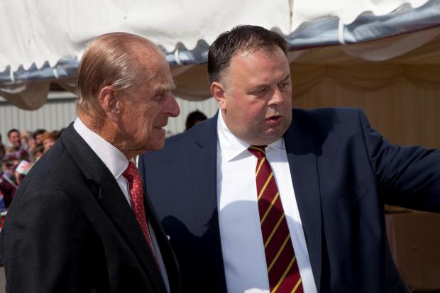 Western Telegraph: HRH Duke of Edinburgh with Huw Thomas at Puffin Produce Picture: Harry Williams Photography'