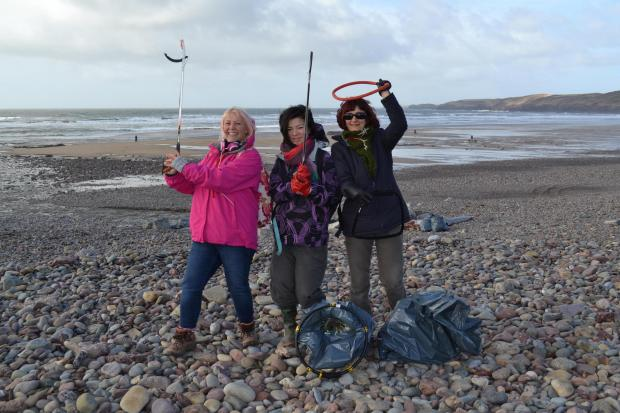 COASTAL CARE: Volunteers during a recent clean-up at Freshwater West. (5846075)