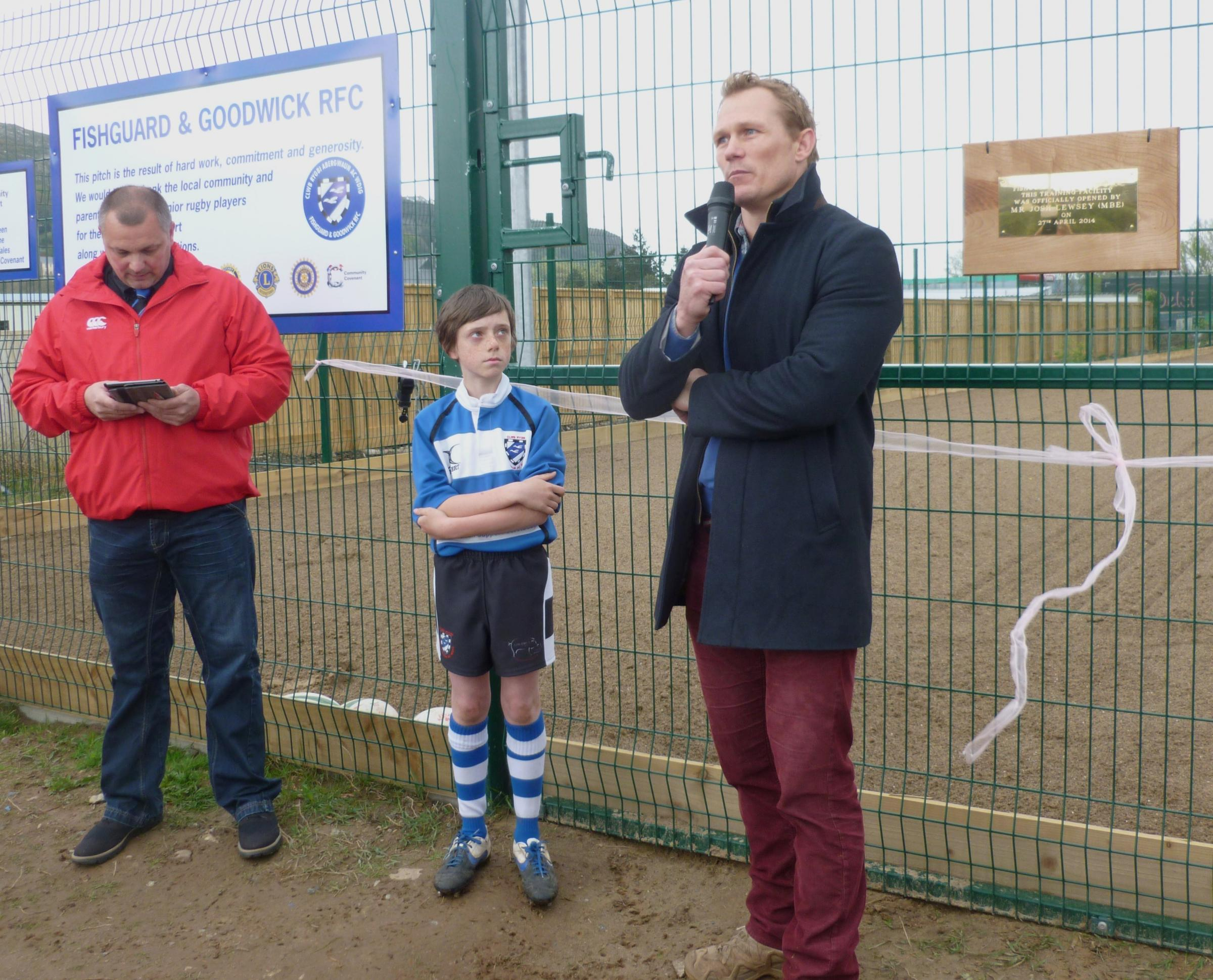 GRAND OPENING: Josh Lewsey (back, centre) with the eager youngsters at the official opening of the Fishg