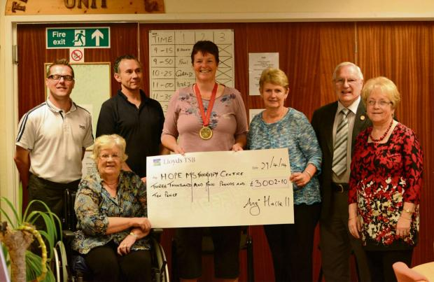 MARATHON EFFORT: Angi and Haulwen present a cheque for more than £3,000 to HOPE chairman Ken Brombley and Margaret Brace, HOPE secretary. (6082250)