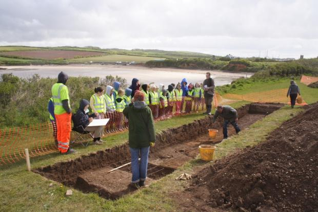 COASTAL ARCHAEOLOGY: Schoolchildren visit an excavation at West Angle beach PICTURE: Dyfed Archaeological Trust.  (6059775)