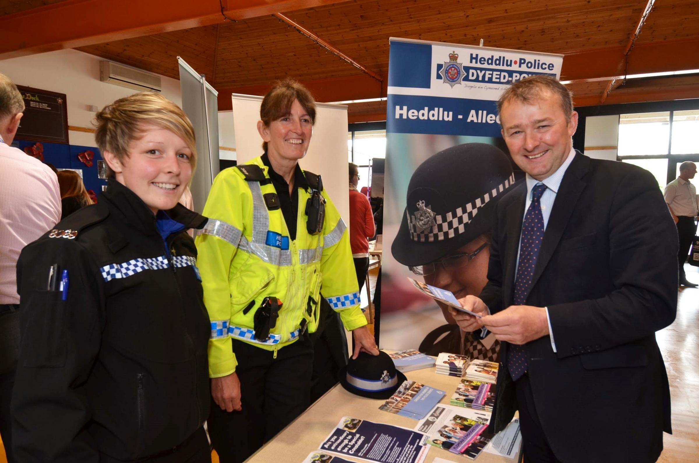 JOBS FAIR: Simon Hart MP talking to Hannah Francis and Alison Foley at the Dyfed-Powys Police stand.  PICTURE: Martin Cavaney.   (614