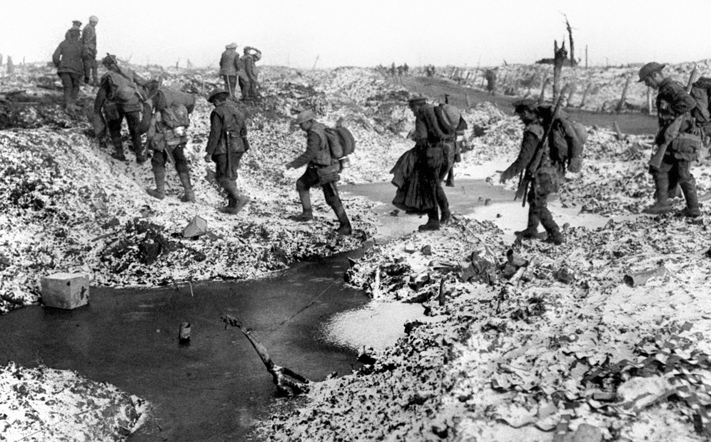 British soldiers negotiating a shell-cratered, Winter landscape along the River Somme in late 1916 after the close of the Allied