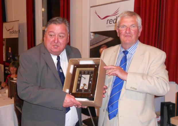WHAT A DIAMOND: Kenny Ellis (left) is presented with an engraved clock by chairman David Hughes. (7574397)