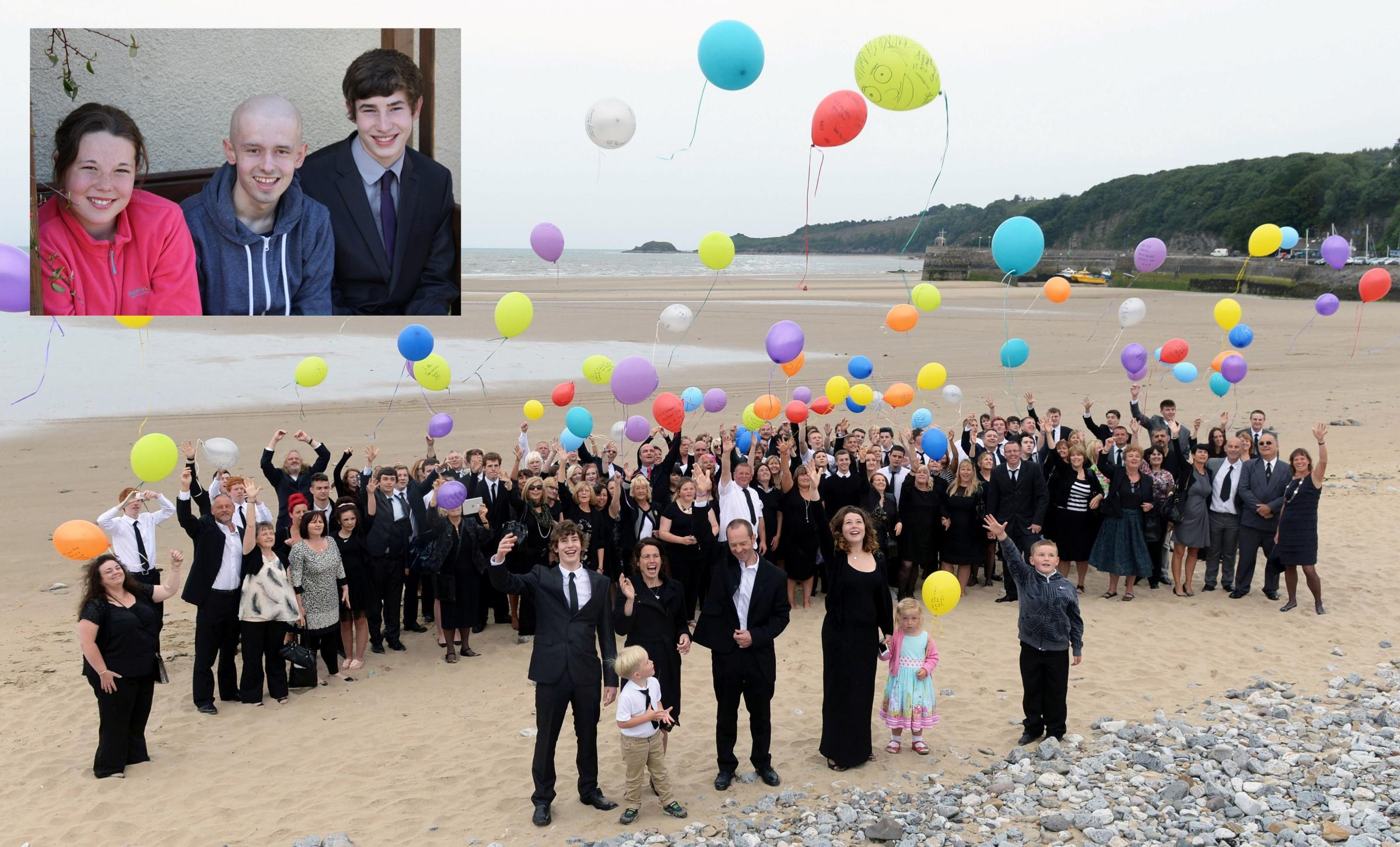 UPLIFTING: Daniel's yellow cartoon balloon (top right) smiles down at his family and friends as they celebrate his life. Daniel is pictured inset  flanked by his sister Nicole and brother Lewis. MAIN PICTU