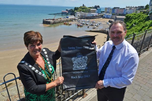 SEA THEM OFF:: Councillor Huw George from Pembrokeshire County Council and the mayor of Tenby, Councillor Sue Lane, are pictured with a gull-proof refuse bag. (7866982)