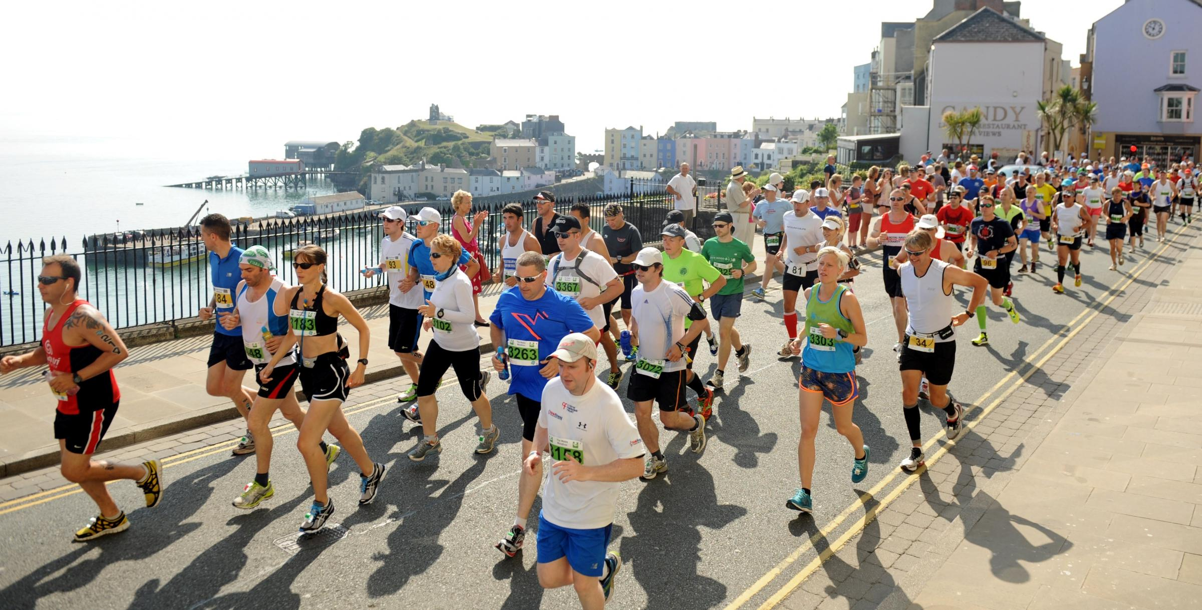 SUNSHINE START: Hundreds of Wales Marathon runners stream their way along Tenby's High Street at the start of the hot and hilly course.PICTURE: Gareth Davies Photography (650308)