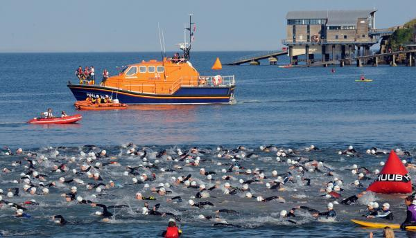 MAKING WAVES: Swimmers take to the water in North Beach on a glorious evening in Tenby. PICTURE: Gareth Davies Photography.