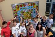 Quilt of many colours: Narberth CP School pupils, teacher Kelly Harrison and artist Linda Norris with the glass artwork. PICTURE: Gareth Davies Photography (8437606)