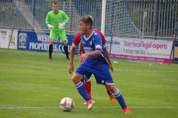 ON THE BALL: Jordan Follows in close control for Haverfordwest County against Cardiff City.