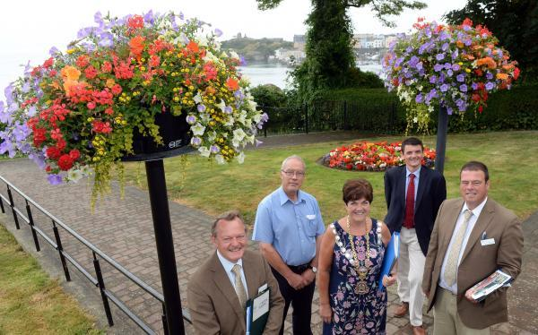 Blooming fine: Britain in Bloom judges Martyn Hird and Rae Beckwith are pictured in Tenby with the mayor, Councillor Sue Lane; Glenville Codd of Pembrokeshire County Council and Tenby's town cler, Andrew Davies. PICTURE: Gareth Davies Photography