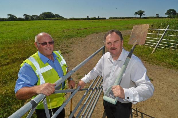 WORK BEGINS At the start of the £2m scheme for a new civic amenity and recycling centre near Saundersfoot, Councillor Huw George (right) is pictured at the site with centre supervisor Terry Reynolds. (8891000)