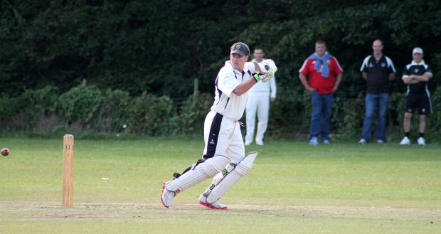 SOLID KNOCK: Neyland's Scott John struck 40 not out for the league leaders against basement team Saundersfoot. (8890263)
