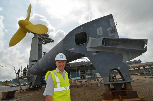 GIANT OF THE WAVES: Tidal Energy Ltd Managing Director Martin Murphy is dwarfed by the giant tidal energy generator.  (9017468)
