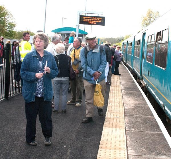 Passengers wait to board the train at Fishguard rail station.