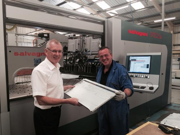 BUSINESS BOOST: CNC machine operator Dave Williams with managing director Ed Spankie and the new machine. (9167084)