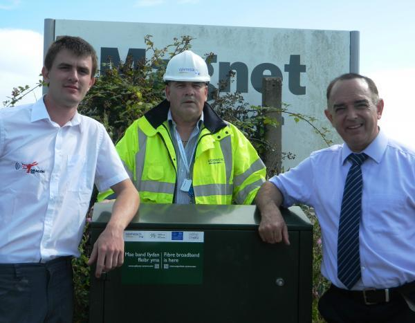 Guy Farley of Dragon Wi-Fi, BT's Alan Farmer and Lord Bourne, Chair of the Haven Waterway Enterprise Zone at the green cabinet on Withybush Trading Estate which will provide superfast broadband during Pembrokeshire County Show.