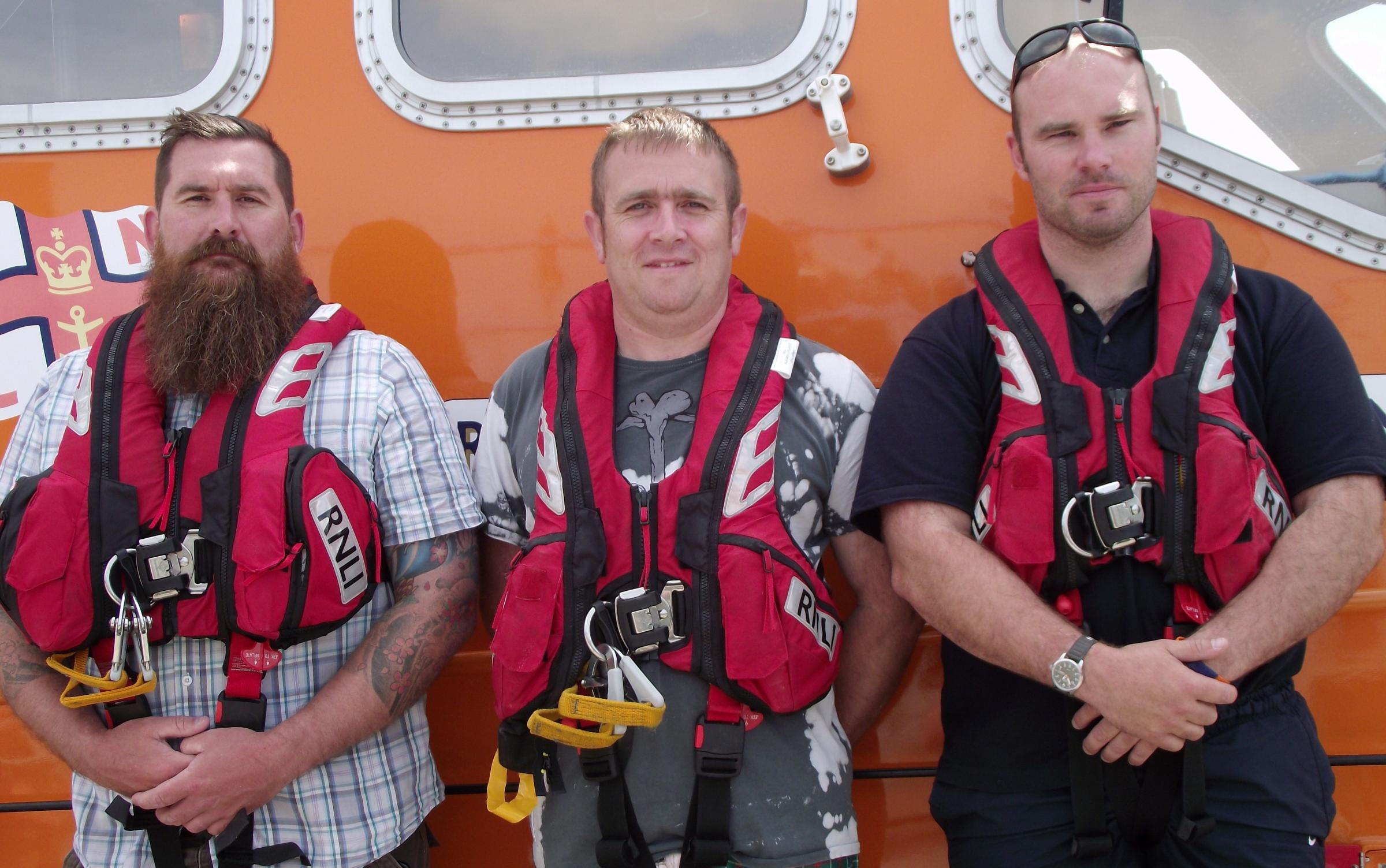 SEA SKILLS: RNLI Angle trainees Michael Higgins and Carl Morgan with Coxswain Lewis Creese. (9414578)