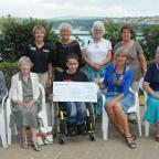 Western Telegraph: Harry is pictured with the cheque for £1,600 to add to the funds already raised by his family. With him are (back row left to right): Angela Miles; Jeanette Griffiths (Harry's sister); Maggie Stringer and Annette Evans. Front row: Wendy Ratcli