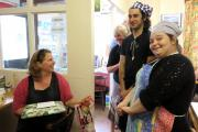 FOND FAREWELL: Tracey Whistance is presented with gifts from the volunteers at Transition Cafe.