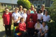 "GROW TEAM: Year 5 children pictured with their ""Buddy Bench"", gardening club leader Mrs Griffiths, Sue Lawton of the British Potato Council and representatives from Puffin Potatoes. (10544153)"