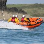 Western Telegraph: READY TO RESCUE: St Davids inshore lifeboat and crew. PICTURE: St Davids RNLI