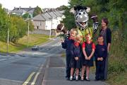 KEEPING SAFE: Sally Jones from the Council's Road Safety Team with Daisy, Mia, Oliver and Korey, from the Meads CP School and road safety mascot Ziggy the Zebra.  (10600036)