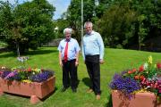FINE FLOWERS: Wales in Bloom judge John Woods was given a tour of Wolfscastle's floral displays by Rev Geoffrey Eynon. PICTURE: Western Telegraph.
