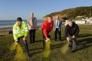 PENDINE PATROL: Highlighting dog fouling hotspots near the seafront are Carmarthenshire County Council's Tidy Towns officer, Brian Mogford; Councillor Jim Jones; Daniel Snaith, Keep Wales Tidy; Pendine Community Council chairman, Peter Bowering and en