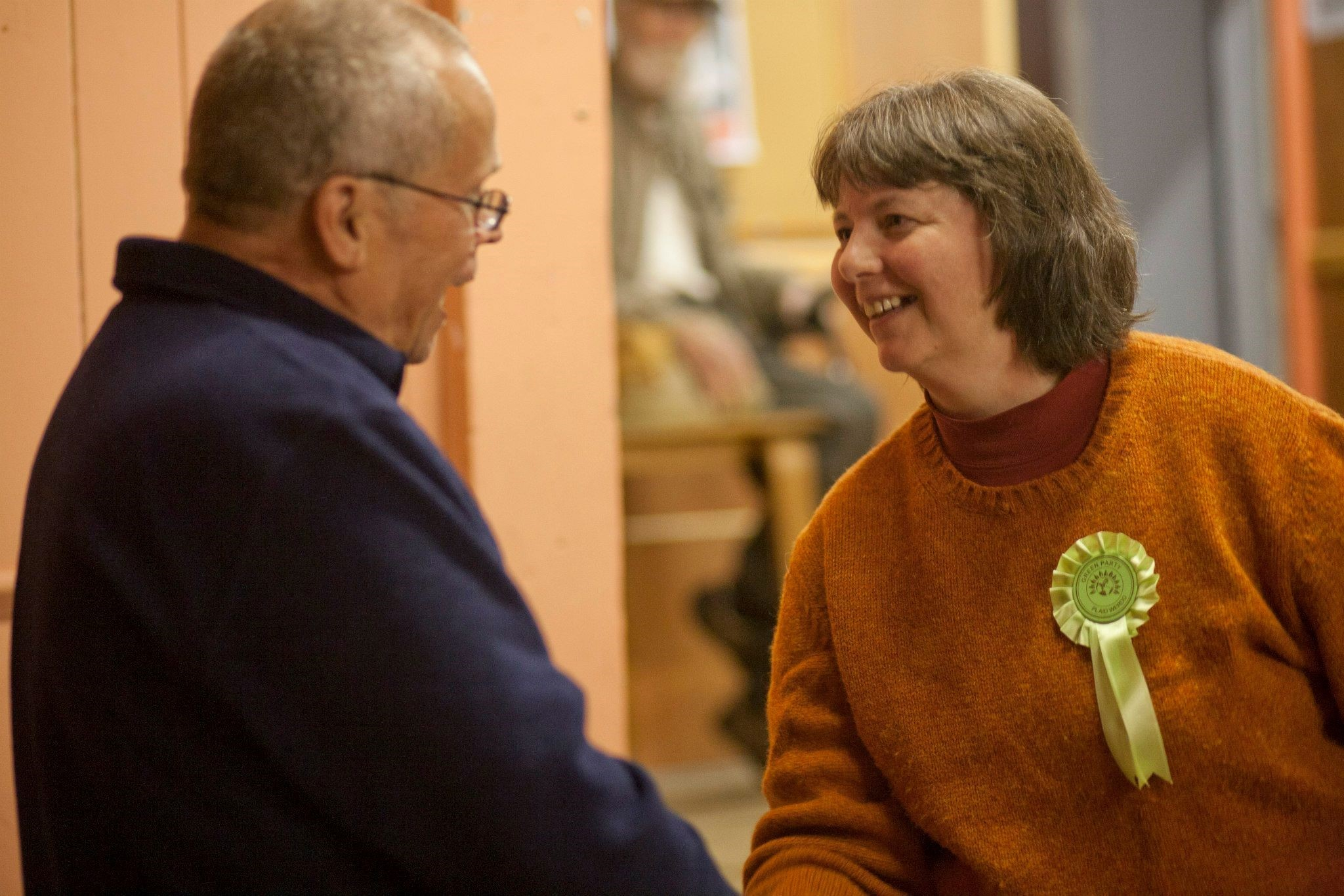 GREAT TO BE GREEN: Frances Bryant, Green Party candidate for Preseli Pembrokeshire, greetsa fellow party member at last week's meeting. (11949455)